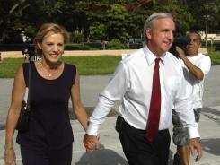 Miami-Dade County Mayor Carlos Gimenez arrives to vote with his wife, Lourdes, on Tuesday.