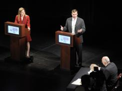 U.S. Rep. Chris Murphy, right, makes a point as he and former Secretary of the State Susan Bysiewicz debate in New London, Conn. on July 30.