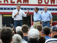 Mitt Romney, left, speaks in front of Tom's Ice Cream Bowl on Tuesday with Ohio Gov. John Kasich, second from right, and U.S. Sen. Rob Portman during his stop in Zanesville, Ohio.