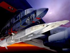 This undated U.S. Air Force illustration shows the X-51A Waverider under the wing of a B-52 Stratobomber.