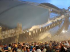 The stage collapses as fans wait to see Sugerland perform at the Indiana State Fair on Aug. 13, 2011, in Indianapolis.