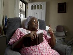 Marian Berkley, 83, of Philadelphia looks at a non-government-issued ID card she has had in her wallet since 2003.