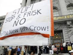 A rally in opposition to a proposed stop-and-frisk police takes place outside of city hall in San Francisco, last Tuesday.