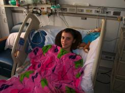 Bailey Quishenberry, suffering from a Clostridium difficile infection, marks her 15th birthday on June 12, 2011, in the hospital.