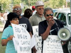 Dr. Isaac Richmond, with megaphone, national director of the Commission on Religion and Racism, leads a protest Aug. 14 in front of Jonesboro, Ark., City Hall to protest the shooting death of Chavis Carter, 21.