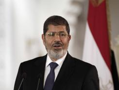 Egyptian President Mohammed Morsi speaks to reporters during a news conference on July 13.