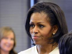 First lady Michelle Obama visited people impacted by the 'Dark Knight' movie theater shooting Aug. 11 in Aurora, Colo.
