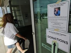 A woman enters a fundraising event for Brent Lowak and the Jessica Ghawi scholarship fund at the Edge Ice Arena, on July 28 in Littleton, Colo.