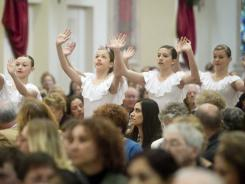 Interfaith service: Dancers perform during an interfaith service in Tucson to mourn a mass shooting in January 2011.