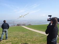 Lian Pin Koh, left, of the Swiss Federal Institute of Technology, conducts a drone test flight in Zurich, Switzerland, on March 15.