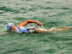 Endurance swimmer Diana Nyad swims off Havana, Cuba, on Saturday as she begins a more than 100-mile trip across the Florida Straits to the Florida Keys.