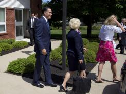 GOP presidential candidate Mitt Romney leaves the Church of Jesus Christ of Latter-day Saints after services Sunday in Wolfeboro, N.H.