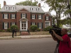 A television cameraman works in front of Rep. Paul Ryan's home in Janesville, Wis., on Aug. 13.