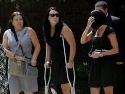 Samantha Yowler, second from left, leaves the Maiden Lane Church of God after the funeral services for her boyfriend, Matt McQuinn, on July 28 in Springfield, Ohio.