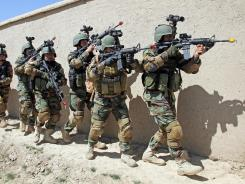 Afghan special forces demonstrate a raid for rescuing a hostage for NATO Secretary-General Anders Fogh Rasmussen at the commando training center in Kabul in April.