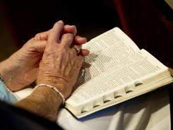 Reading the Bible used to mean reading a book, but increasingly, people are getting the Word on smartphones, iPads and other electronic devices.
