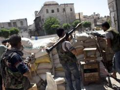 Rebel fighters are seen in one of their forward positions in Aleppo, Syria, on Saturday.