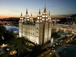 This April 27, 2006 file photo shows the sun setting behind the Mormon Temple, the centerpiece of Temple Square, in Salt Lake City.