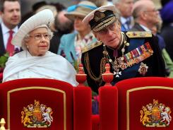 Britain's Queen Elizabeth II and Prince Philip, Duke of Edinburgh, stand onboard the Spirit of Chartwell June 3 during the Thames Diamond Jubilee Pageant in London.