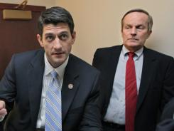 Rep. Todd Akin, R-Mo., listens to Rep. Paul Ryan, R-Wis., prior to a news conference on Capitol Hill on April 5, 2011.
