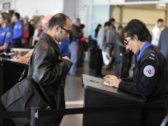 A TSA agent interviews a flier as part of the pilot program for enhanced behavior detection at (Boston's) Logan International Airport last October.