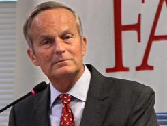 Todd Akin, Republican candidate for U.S. senator from Missouri, takes a question from the audience after speaking at the Missouri Farm Bureau candidate interview and endorsement meeting in Jefferson City, Mo., on Aug. 10.