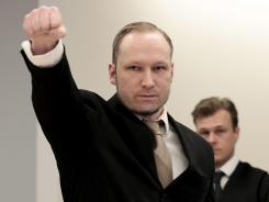 Anders Behring Breivik, shown in April, gestures as he arrives at the courtroom, in Oslo, Norway.