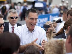 Mitt Romney shakes hands during a campaign event at Watson Truck and Supply on Thursday in Hobbs, N.M.