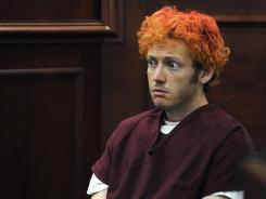 James Holmes appears in Arapahoe County District Court in Centennial, Colo.