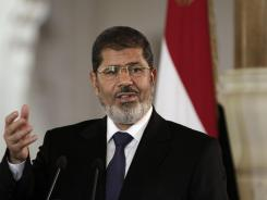 Egyptian President Mohammed Morsi speaks to reporters in Cairo, Egypt, on July 13.