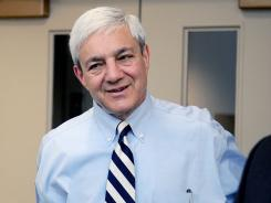 Graham Spanier arrives at the University Park Airport in State College, Pa., on July 12.