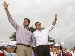Republican ticket: Presidential candidate Mitt Romney and his running mate Paul Ryan greet the crowd at a campaign event in Waukesha, Wis., on Sunday.