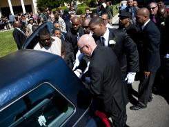 Rodney King's casket is placed in a hearse before the funeral procession, outside the Hall of Liberty at Forest Lawn-Hollywood Hills, Los Angeles on June 30.