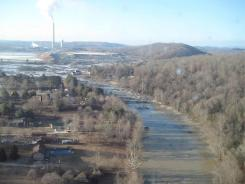 This file handout photo provided by the Tennessee Valley Authority shows the massive ash spill at the Kingston Fossil Plant in Kingston, Tenn.