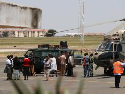 A Kenya Air Force helicopter transporting the bodies of Ugandan Army personnel who died in a helicopter crash on Mount Kenya on Sunday is parked on the tarmac at Wilson Airport in Nairobi, Kenya.