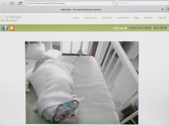 A webcam feed shows Emily St. Martin on Aug. 13 at Ochsner Medical Center near New Orleans. Her parents watch her from their LaPlace, La., home.
