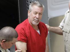Former Bolingbrook, Ill., police sergeant Drew Peterson arrives at the Will County Courthouse in Joliet, Ill. for his arraignment on charges of first-degree murder in the 2004 death of his former wife Kathleen Savio.