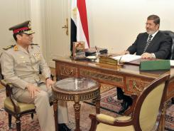 Egyptian Minister of Defense, Lt. Gen. Abdel-Fattah el-Sissi, left, meets with Egyptian President Mohammed Morsi at the presidential palace in Cairo, Egypt, Aug. 22.
