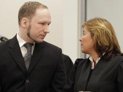 Anders Behring Breivik talks to his lawyer Vibeke Hein Baera in the courtroom in Oslo where he was sentenced to prison.