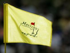 "FILE - This April 7, 2006 file photo shows a Masters pin flag flying on the 16th hole during second round play of the Masters golf tournament at the Augusta National Golf Club in Augusta, Ga. For the first time in its 80-year history, Augusta National Golf Club has female members. The home of the Masters, under increasing criticism the last decade because of its all-male membership, invited former Secretary of State Condoleezza Rice and South Carolina financier Darla Moore to become the first women in green jackets when the club opens for a new season in October. ""This is a joyous occasion,"" Augusta National chairman Billy Payne said Monday, Aug. 20, 2012. (AP Photo/Morry Gash, File) ORG XMIT: NY157"