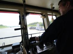 Tugboat captain Ron Mook navigates the Mississippi River Friday near Greenville, Miss.