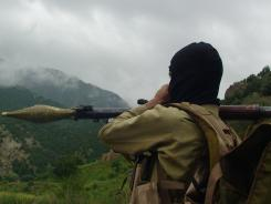 A Pakistani Taliban militant holds a rocket-propelled grenade at the Taliban stronghold of Shawal in the tribal region of Waziristan, Pakistan, on Aug. 5. The U.S. has long viewed the Haqqani network as one of the biggest threats to U.S. and NATO forces in Afghanistan as well as the country's long-term stability.