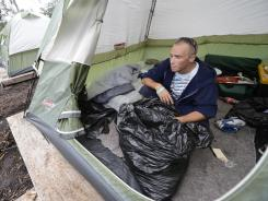 John Bouchard, 30, packs his belongings in plastic bags Sunday at the Pinellas Hope tent camp in St. Petersburg, Fla.