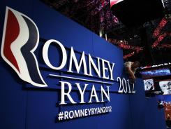Republican Convention: A worker hangs a sign ahead of the Republican National Convention at the Tampa Bay Times Forum on August 26, 2012 in Tampa, Florida.