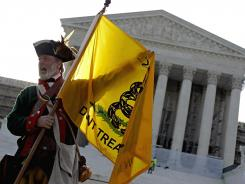 A Tea Party supporter protests ObamaCare in front of the Supreme Court in Washington, D.C., in June.