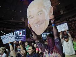 Ron Paul supporters show their support for the Texas congressman at a rally Sunday in Tampa.