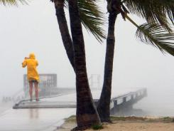 Tropical Storm Isaac's winds and rain whip around Sunday at Clarence Higgs Beach in Key West.