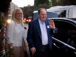 U.S. gaming tycoon Sheldon Adelson and his wife, Miriam, leave after Mitt Romney delivered a speech July 29 in Jerusalem.