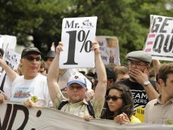 """Sparse crowd: Protesters gather as part of """"March On The RNC"""" in Tampa on Monday. Bad weather kept many from attending."""
