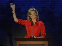 Ann Romney waves as she takes the podium to speak at the Republican National Convention Tuesday night in Tampa.